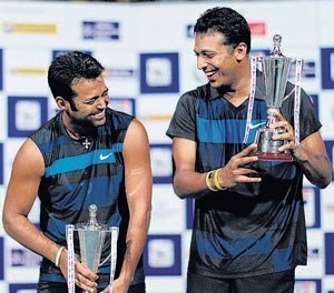 Leander Paes (left) and Mahesh Bhupathi share a light moment after winning the doubles title on Sunday. PTI