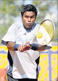 Top seed Vijay Sundar Prasanth essays a backhand during his win over Karnataka's Sagar Manjanna in the Enerzal Open tennis tournament. DH PHOTO