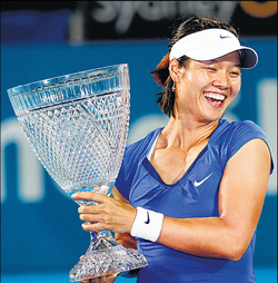 China's Li Na is over the moon after defeating Kim Clijsters for the Sydney International crown. AP