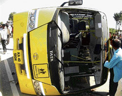 The school bus that overturned duringthe accident near Marasanahalli in Chikkaballpur on Monday. DH file photo
