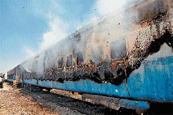 Fire: A fire personnel dousing the flames after a condemned bogie caught fire at the Ashokapuram Railway Station in Mysore on Friday. DH photo by Prashant H G