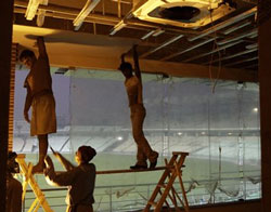 Labourers work on the viewers gallery of Eden Gardens in Kolkata on Thursday. The International Cricket Council has ruled out Eden Gardens as a venue for a World Cup group match between India and England on February 27 and a new venue is expected to be proposed soon. PTI