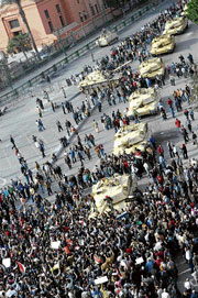 No letup: Egyptian protesters gather near army tanks in Cairo's central Tahrir square on Monday. AFP