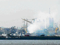 Fire on water: Smoke rises from the INS Vindhyagiri at the naval dockyard in Mumbai on Monday. AFP