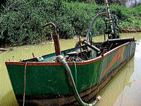 A boat with motor fit to it used for sand mining. DH PHOTOS