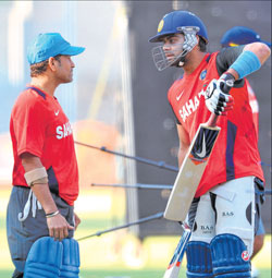 Sachin Tendulkar has a tip or two for Virat Kohli at the nets in Bangalore on Friday. DH Photo