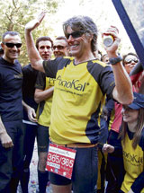 MARATHON MAN Belgian marathon runner Stefaan Engels celebrates his entry into the Guinness Book of world records for the most consecutive marathons  after completing a race in Barcelona. REUTERS