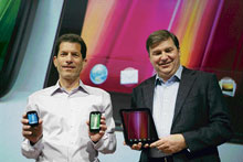 HP Palm senior vice-president and general manager Jon Rubinstein (left) and senior vice-president of application and service Steven McArthur pose with the HP tablet, Touch Pad during the WebOS event in San Francisco. AFP