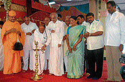 Lighting the lamp: State's Special Representative at New Delhi and former union minister, V Dhananjaykumar inaugurating various religious programmes organised at Srikeshthra Shravanabelagola in Channarayapatna taluk of Hassan district on Sunday. DH photo
