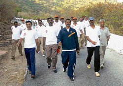 Forward march: DCP (Crime and Traffic) P Rajendra Prasad leads the cops during a climb up the Chamundi Hills in Mysore recently. DH photo