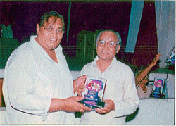 A file photo of Dr H K Ramanath receiving an award from late cine actor M P Shankar. (Pic by special arrangement)