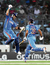 Celebration time: Virat Kohli jumps in joy after reaching his century against Bangladesh in Dhaka on Saturday. Reuters