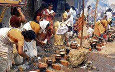 Annual affair: Cutting across class, caste and religious barriers, thousands of devotees congregated around the Attukal Bhagavathy temple in Thiruvananthapuram on Saturday to perform the annual ceremony of cooking a rice-jaggery mix in fresh earthen pots as their offering to the presiding deity of the shrine. Photo courtesy/Janmabhumi