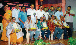 AN HONOUR TO THE FEEDERS: Farmers Jayalakshmi, Suresh Naika, Narasimha Kamath, Andrew Lobo and Panduranga Nayak being feted at the farmers' meet in Udupi on Saturday. DH PHOTOS
