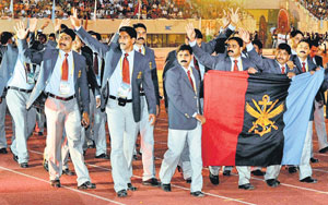 Overall champions Services team waves to the crowd during  the closing ceremony of the National Games. PTI