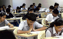 Testing times Students write an ICSE exam at St Ann's High School in Rajajinagar on Monday. DH photo