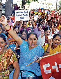 in protest: Members of ASHA stage a protest demanding better amenities, in Bangalore on Monday. DH photo