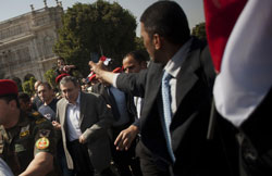 Treading a new path: Egypt's new prime minister Essam Sharaf is escorted by police and members of the Egyptian Military towards Tahrir Square, the focal point of the Egyptian uprising earlier this year, in Cairo on March 4. NYT