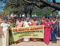 Women taking out a procession as part of the International Women's Day celebration in Chikmagalur on Tuesday.