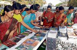 Women take a look at the books on display at the exhibition on Saturday.DH photo