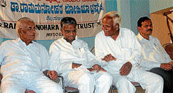 MEN in white: Former speaker Krishna (third from left) sharing a word with MLA V Sreenivasprasad, at an interaction on corruption, in Mysore on Monday. (L-R) Socialist P Mallesh and former MLA A T Ramaswamy look on. Dh photo