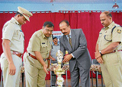 District and Sessions Judge Ashok G Nijagannavar inaugurating the workshop for the police to bring awareness about Lockup death at Maitri Bhavan, Madikeri. SP Manjunath Annigeri, DySP Jayaprakash and Annappa Nayak look on.
