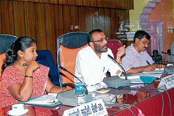 Zilla Panchayat President Shanteyanda Ravi Kushalappa presiding over the KDP Review meeting at Old Fort Hall in Madikeri on Thursday.