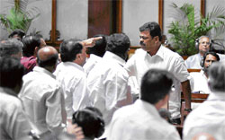 "Finger-pointing: Excise Minister M P Renukacharya (right) in a heated argument with JD(S) MLCs in the Legislative Council on Thursday, after Chief Minister B S Yeddyurappa described the Gowda family as ""a curse on Karnataka"". DH Photo"