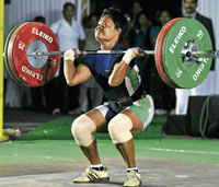 Iron woman: Manipur's Shaya Devi during her gold medal-winning performance in the 53 kg category. DH photo
