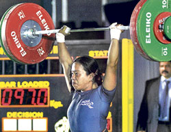 POWER-PACKED: Karnataka's Chandreshori Devi makes a good lift in snatch to pocket the 58kg gold in the National  weightlifting championship at the Sree Kanteerava stadium on Thursday. DH PHOTO