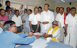 TN Chief Minister M Karunanidhi filing his nomination papers to contest from Tiruvarur seat in Tiruvarur on Thursday. PTI