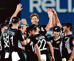 Cut above: Jacob Oram (centre) was the hero for the Kiwis as they crushed South Africa on Friday. DH Photo/ Srikanta Sharma R