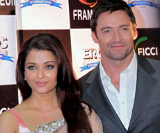 Aishwarya Rai Bachchan and Hollywood actor Hugh Jackman pose for the media during FICCI frames 2011 in Mumbai. PTI