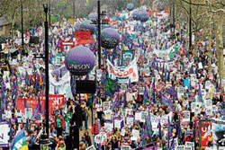 Demonstrators at the beginning of their march in London to protest against government spending cuts on Saturday. AP