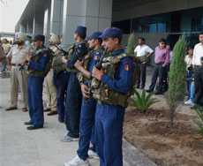 Security men stand guard outside airport before arrival of Pakistani cricket team for the World Cup Semi final match against India, in Chandigarh on Friday.
