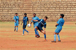 skill: Players of Mysore and Bijapur vie for the ball at the inaugural match of the Inter-District Football Championship at the Chamundi Vihar Grounds, in Mysore on Sunday. DH photo