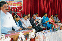 Assembly Speaker K G Bopaiah speaking at the 62nd annual day celebrations of FMC College in Madikeri on Monday. DH PHOTO