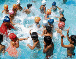 Cool: Many children take to swimming during summer vacation.