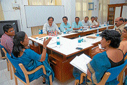 District In-Charge Secretary Dr Amita Prasad briefing officials at a review meeting, in Mysore on Monday. ZP CEO G Satyavati, Deputy Commissioner Harsh Gupta, MCC Commissioner K S Raykar, MUDA Commissioner Dr C J Betsurmutt and others are also seen. Dh photo