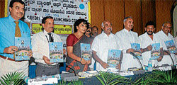 Credit policy: MP H Vishwanath releasing the District Credit Plan 2011-12, at the Zilla Panchayat Auditorium, in Mysore on Tuesday. (L-R) S Shivanna, Abhay Nath, ZP CEO G Sathyavathi, MLAs Chikkanna, H P Manjunath and M Satyanarayana are also seen.  Dh photo