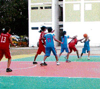 Sporty: Basketball is a favourite activity during summer holidays.