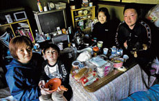 Surviving on pittance: Seiko Taira with her grandson Riku Kanno, daughter Satomi Kanno and  son Hiroyuki Akimoto at their home in Ayukawa, Japan. The family members have been surviving on rations of one meal per day since the tsunami hit on March 11. NYT