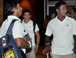 Sri Lankan skipper Kumar Sangakkara (L) and teammate Ajanta Mendis (R) after their arrival in Mumbai on Wednesday for the CWC 2011 final match. PTI