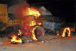 A tractor was set on fire in a group clash between dalits and  Nayakas at Algud in T Narasipur taluk on Thursday. DH Photo