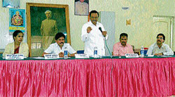 Meeting: Member of Legislative Assembly H S Prakash addressing the general body meeting of City Municipal Council, in Hassan on Thursday. CMC Vice-President Vidya, President C R Shankar and Commissioner Shivananjegowda are also seen. Dh photo