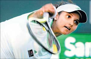 India's Sania Mirza serves en route to her win against Germany's Sabine Lisicki during their Family Circle Cup match on Thursday. Reuters