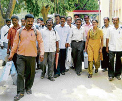 Dutybound: Officers on election duty leave for their respective booths in Channapatna Assembly constituency on Friday. KPN