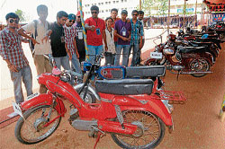 Automobile frenzy:Students of Vidhyavardhaka College of Engineering (VVCE) admire vintage motorcycles at 'Crusades 2011', at their college grounds, in Mysore on Saturday. DH photos by anurag basavaraj
