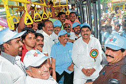 Minister for Transport and Home R Ashoka takes a ride as part of the 'Bus Day' observed in Mysore on Saturday. Minister for Medical Education and District In-charge Minister S A Ramdas, Chairman of Karnataka Housing Board G T Devegowda, MLC Siddaraju, City BJP President Shivakumar, Chairman of Mysore Urban Development Authority L Nagendra and others are seen. DH Photo