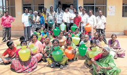Women from Koornahosahalli stage a protest in front of Bescom office in Malur on Monday, demanding regular supply of power and drinking water. DH photo